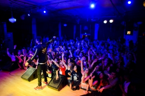 Nico G4 extends his microphone into the surging crowd at the WOW Hall. Los Angeles rapper Dom Kennedy headlines a night of rap and hip-hop at the WOW Hall in Eugene, Ore. on March 17, 2014. (Michael Arellano/Emerald)